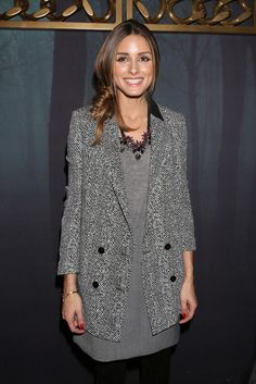 Olivia Palermo poses at the Elisabetta Franchi - Presentation during Milan Fashion Week Womenswear Autumn/Winter 2014 on February 19, 2014