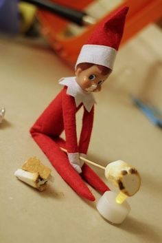 Elf on shelf roasting marshmallow