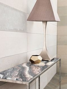 Capricorn table lamp in Pink Silver on a Siena Console table with in Antique Silver finish with a Rosso Luna marble top.