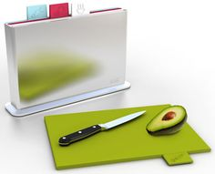 indexfour different chopping boards for different items. looks great. An eye-catcher in the citchen