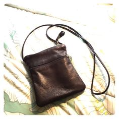 SALE! Dark brown leather pouch Cute brown leather bag, three pockets (one small zip pocket in front, one pocket in back), perfect for when you don't want to carry a heavy purse! Never used. Sven Bags Mini Bags