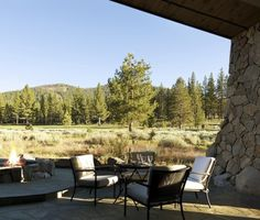 I Like The Sloping Stone Wall And Fire Pit. Great View. Love Trees.