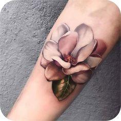 Magnolia made by at Los Angeles CA Flower Wrist Tattoos, Girly Tattoos, Nature Tattoos, Flower Tattoo Designs, Pretty Tattoos, Love Tattoos, Beautiful Tattoos, Body Art Tattoos, Small Tattoos