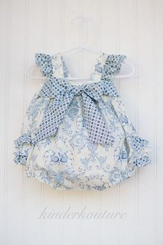 The April Bunny Baby Bubble is one our bestselling items in This gorgeous baby bubble is full of details such as an elasticiized back bodice, a large bow that adorns the front, buttons in the cr Little Kid Fashion, Baby Girl Fashion, Kids Fashion, Baby Clothes Patterns, Clothing Patterns, Sewing For Kids, Baby Sewing, Baby Dress Design, Romper Pattern