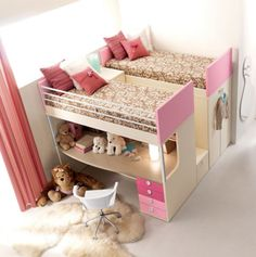Kids room... Cute bunk beds with desk. Space saver. But lots of wasted spaced under that right bed. I'd have a door...and closet in there!