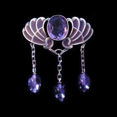 Jugendstil brooch, a silver plique-a-jour enamel brooch set amethyst with three…