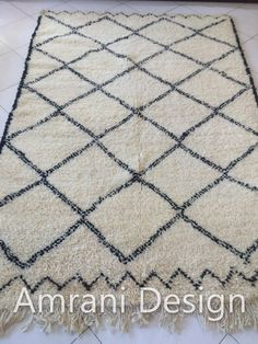 Posh #Beni #Ourain rugs made of 100% authentic sheep wool, by Amrani Design are designed in simple #geometric prints to add more element to your #livingroom. Buy here!