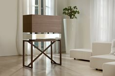 """Nando"" Trolley bar cabinet with walnut base, maple shelves, chromed metal frame and mirrored drawers. Pinworthy Tables and Consoles We Love at Design Connection, Inc. 