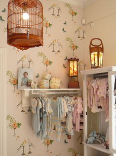 Love the idea of hanging sweet baby clothes from a shelf on the wall, esp when they are tiny.