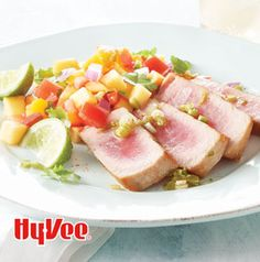 Grilled Tuna Steaks with Peach Salad are fabulous for dinner, but they're great appetizers too! Chop the tuna into pieces and pile onto crackers with a bit of salsa.