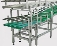 has designed and built a buffer system that manages the queue of reusable totes in a production line. The system presents full totes for processing via belt-driven and accumulates empty totes using a gravity roller conveyor. Conveyor System, Puffer, Empty, Bar Stools, Totes, Presents, Belt, English, Design