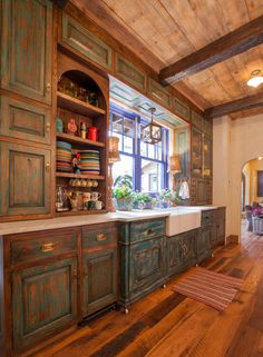 Cool refinished rustic cabinets. Texas residence by Georgiana Design.
