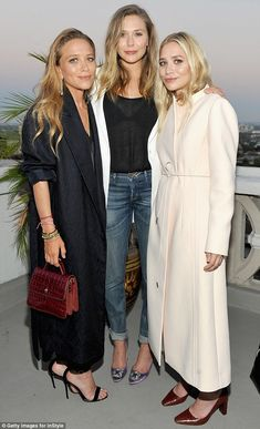 They came in three! Designers Mark-Kate and Ashley Olsen joined their younger sister Elizabeth at the Tuesday celebration of the opening of their new store Elizabeth And James in LA