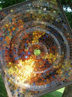 Stained glass mosaic, on clear glass base. Very nice.  Great inspiration.