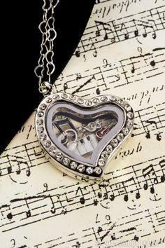 Whether you're a beginner or a virtuoso, this lovely locket is sure to strike a chord.