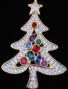 New Authentic Rare 2001 Retired Swarovski Christmas Tree Pin Brooch Signed with the Swarovski Swan logo and the date 2001.