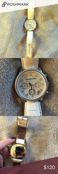 White Michael kors watch White crocodile print patent leather. Just replaced the battery 2 months ago. The only wear is shown on the band which isn't noticable when wearing Michael Kors Accessories Watches