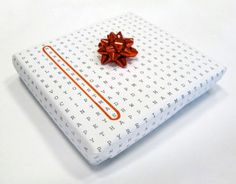 Crossword wrapping paper.  I think I will do this at x-mas time but arrange the letters to have Merry Christmas and the names of everyone in my family getting gifts.  I will likely go to Staples and get them to make a few big poster sheets of it.