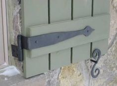 Strap Hinge And Shutter Dog Combination For A Wooden Window Door