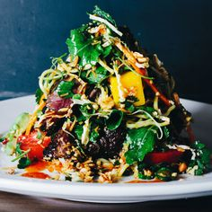 This is no simple salad: It's a multicourse meal on a plate. Its dramatic presentation is part of the allure. Worth making for the dressing alone. Thai Steak and Noodle Salad - Bon Appetit Thai Recipes, Asian Recipes, Cooking Recipes, Avocado Recipes, Arugula Recipes, Mango Recipes, Noodle Recipes, Cilantro Recipes, Thai Steak Salad