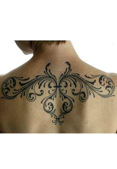 shoulder scroll tattoo