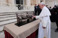 In 2013, Pope Francis prays at a model of the Homeless Jesus sculpture in St. Peter's Square. It's Canadian!