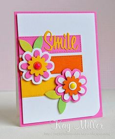 handmade card from My Joyful Moments: The Cutting Edge Challenge #7 ... bright and hot summer colors ... all die/machine cut elements ... layer flowers, SMILE and three bands of color with embossed stitching along the edges ...