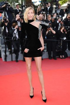 Cannes Film Festival 2017 | British Vogue  Anja Rubik paired her Saint Laurent by Anthony Vaccarello dress with Boucheron jewellery.