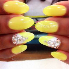 Neon glowing yellow nails with rhinestones by @infamously_quiet.