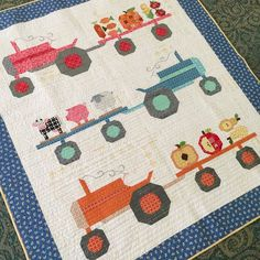 I want to show you something fun that we did for our Farm Girl Vintage Retreat last week.This is my Farm Girl Tractor (without embroidery yet)  The pattern for the tractor block is on page 82 in my bo