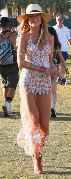 Flower power: Kimberley Garner wowed in a sheer floral dress on her final day at the Coach...