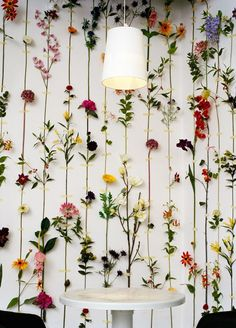 fake flowers to decorate a blank wall. Genius.