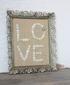 Make something like this to hang in my room- buttons glued on burlap with a cute thrift shop frame