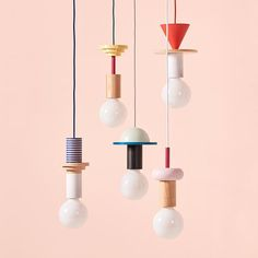 All the curated Junit lamps suspended together and set up in a colorful group - which one is your favorite?