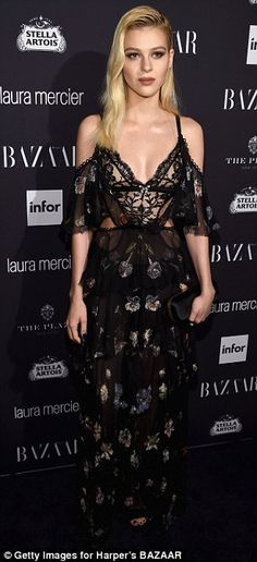 Lacy lady: Nicola Peltz opted for an off-the-shoulder floral frock with a saucy lace corse...