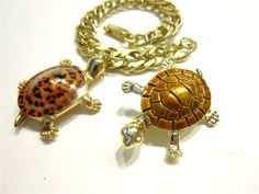 Coolest turtle charm bracelet EVER! He is adorable, spotted enamel work on the back, he measures 1 1/2 with bale. He can be removed and put on a necklace? Right now he comes on a very heavy gold tone linked chain bracelet, measuring 6 5/8 when clasped. Its in incredible condition and an extra turtle pin included!!  U.S. Shipping is 3.50 Thank you! #11