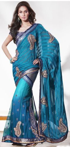 Blue color net and brasso base lengha saree with blouse