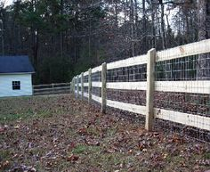 3 rail board fence with attached woven horse wire