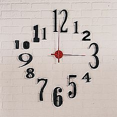 Jumbo wall clock with numbers in varying fonts/sizes for the playroom. Been wanting this exact thing for a few years now