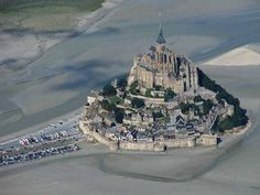 Mont Saint-Michel (4 hours by car,  not sure how long or how much money by train and bus)