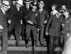 Al Capone (in white hat) emerged from a federal building in Chicago after his trial on Dec. 10, 1931. The gangster was convicted of five counts of tax evasion and failing to file a return. (Associated Press/FILE)