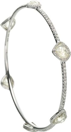 Orielle bangle bracelet featuring six rough diamonds totaling 14.90cts accented with 2.44cts of m...