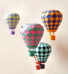 i'm thinking of making a mobile of clouds and hot air balloons.Woven Paper Hot Air Balloon Mobile (via Paper Matrix) Kids Crafts, Craft Projects, Arts And Crafts, Craft Ideas, Weaving Projects, Decor Crafts, Diy Ideas, Craft Tutorials, Easter Crafts