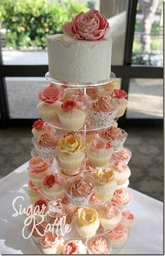 Wedding Cake and Cupcakes (replace some tiers with different desserts and use fresh flowers on top of cake)