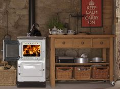 The Esse is a compact wood stove with single oven, bullseye target hotplate, and a domestic hot water boiler. Gas and electric versions also available. Wood Stove Modern, Cooking Mussels, Stoves For Sale, Cooking Stove, Cooking Fish, Cooking Quotes, Single Oven, Range Cooker, How To Cook Fish
