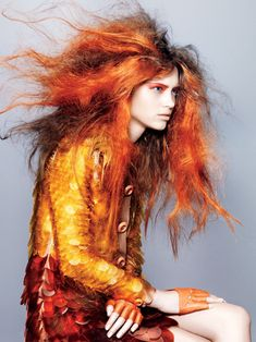 Fire starter editorial photo.  Amber and rust scaled jacket dress.