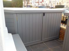 Bike shed built to fit the angles of this bay window in London. Painted in soft grey. Accompanied by bespoke bin store and additional cover for electric meters. Bin Store, Firewood Shed, Bike Shed, Garden Painting, Building A Shed, Shed Plans, Bay Window, Outdoor Furniture, Outdoor Decor