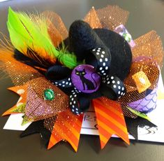 Witches Hat Bow from Larkie Lu Bows..$18 www.larkielubows.com These are not on the website but can be made by contacting Gina w/ LLBOWS