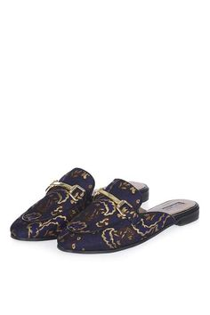 Channel off-beat cool in these quirky backless loafers in purple printed fabric with a metal trim. #Topshop