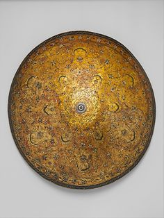 Pageant Shield    Date:      ca. 1580  Culture:      Italian (Venice)  Medium:      Wood+leather+gilding+polychrome= SWAG